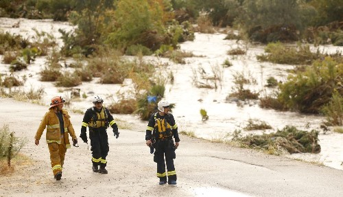 Water rescues, floods and power outages as rain drenches parts of Southern California