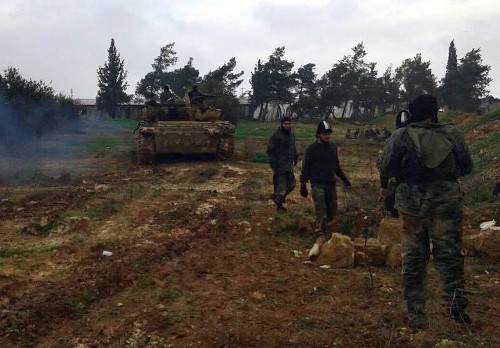 Al Qaeda-linked fighters seize two Syrian army bases