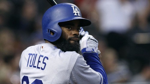 Dodgers say Andrew Toles hasn't reported to spring training because of 'personal matter'
