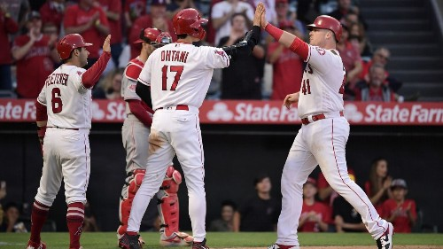 Justin Bour's home runs power Angels past Reds for the sweep