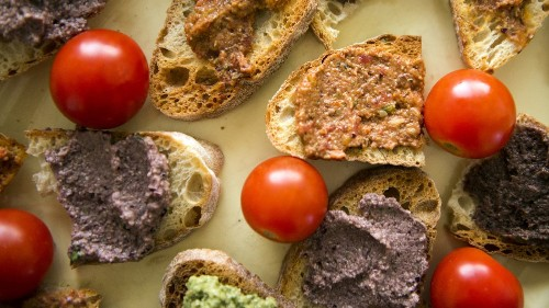 Making tapenade, the Provençal olive paste, for a California kitchen