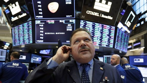 Stocks end mixed after gloomy economic report, another drop in bond yields