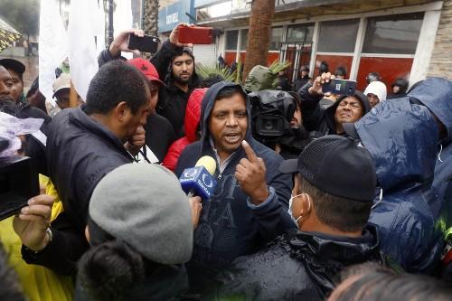 Facing pressure from Trump, Mexico detains two migrant caravan organizers
