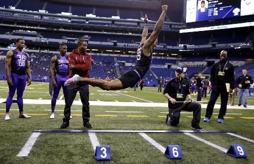 UConn CB Byron Jones beats broad jump world record at NFL combine - Los Angeles Times