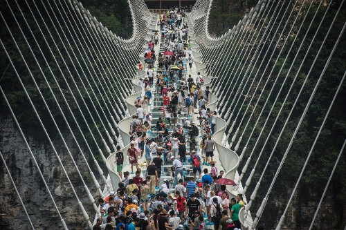 China's highest, longest glass bridge closes after too many people come to visit