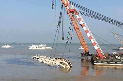 Many tears, few answers at site of China ship tragedy; death toll jumps to 406