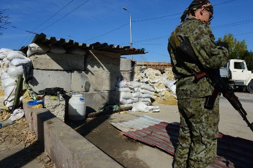 Ukraine cease-fire pressured by pro-Russia attacks, weapons buildup