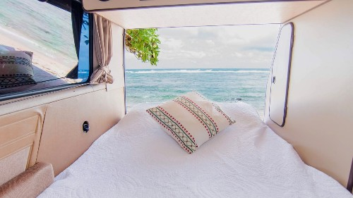 Volkswagen camper vans for rent on Kauai means camping on the beach