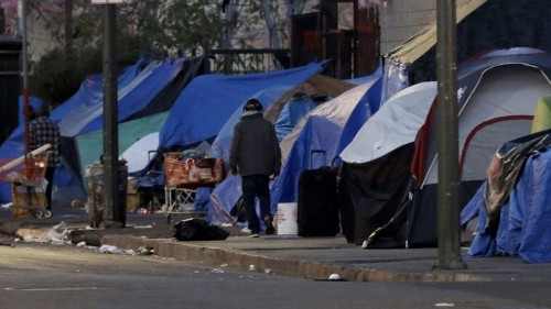 LAPD officer is severely beaten on skid row and left in critical condition