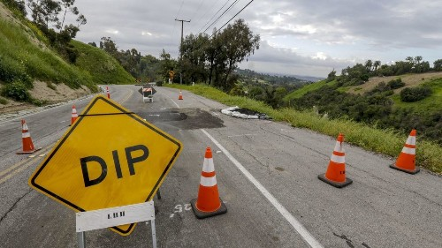 A busy traffic link between L.A. and Orange counties is closed for at least a year