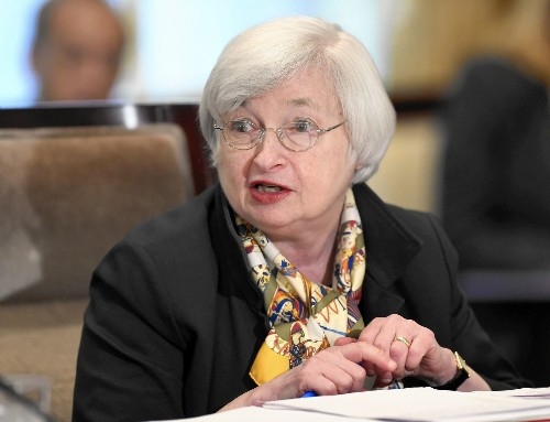 Fed declares economy strong enough for bond-buying stimulus to end