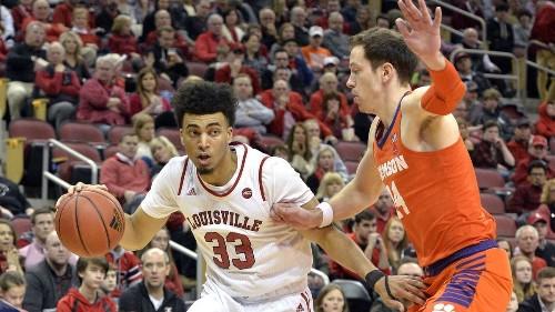 College basketball: Louisville avoids upset bid by Clemson