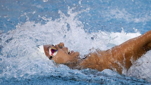 Baker is good and lucky with world record in the 100 backstroke at U.S. swimming championships