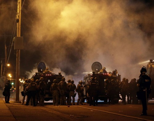 Tear gas fired on a new round of protests in Ferguson Sunday night