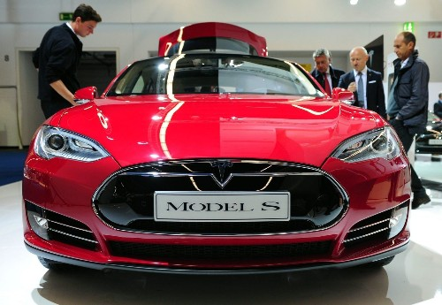Tesla hires Apple exec to lead new car development