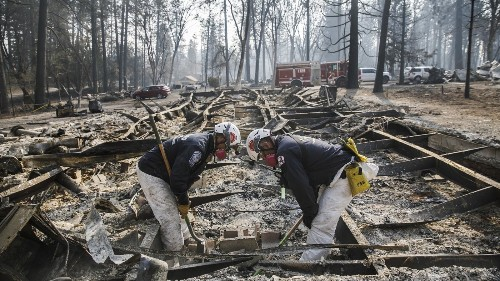 Rescuers fear rains will wash away victims' remains; 870 still missing in California fire - Los Angeles Times