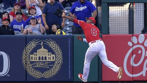 Justin Upton injured during Angels' defeat of Dodgers in Freeway Series opener
