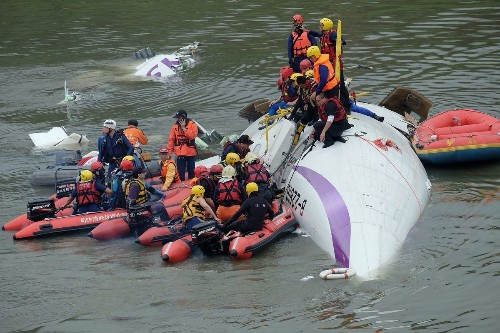 Plane clips bridge and crashes into Taiwan river, killing at least 26