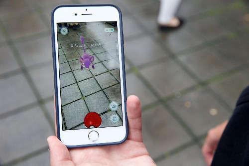 'Pokemon Go' maker dreams of video games played on contact lenses