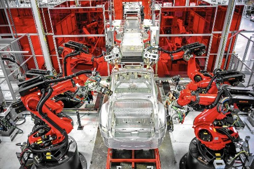 Tesla factory racing to retool for new models
