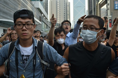 In Hong Kong, opponents scuffle with pro-democracy protesters