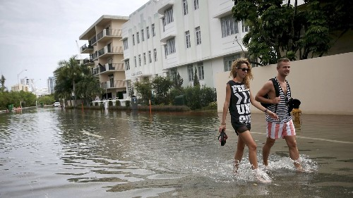 Trump's climate science denial clashes with reality of rising seas in Florida