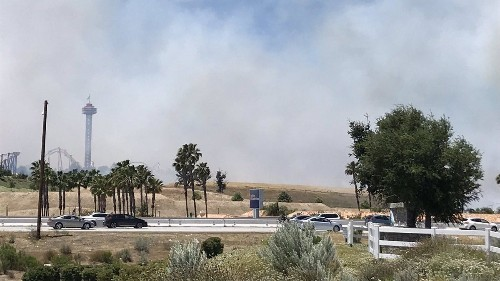 Magic Mountain evacuated as fast-moving brush fire burns nearby