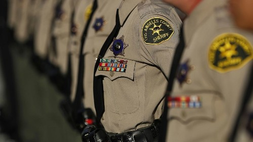 Inked with a skull in a cowboy hat, L.A. County sheriff's deputy describes exclusive society of lawmen at California station