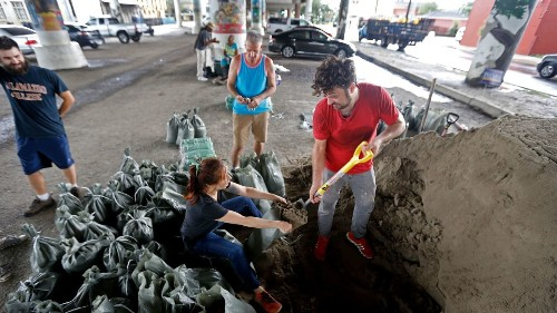 New Orleans braces for new flooding as it copes with power outages, failed pumping system
