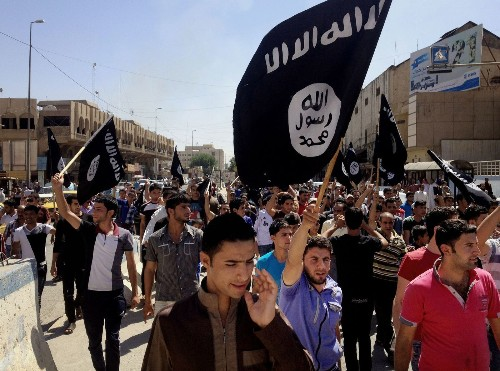 Militants declare Islamic state in Iraq, Syria as Tikrit battle rages