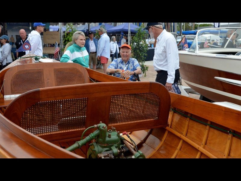 Boat owner and builder since 1992, Dave Carroll of the boat Uncle Erwin chats with guests Saturday at the sixth annual Newport Beach Wooden Boat Festival at Balboa Yacht Club. (Susan Hoffman)