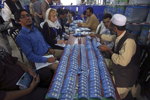 Afghans begin audit of disputed election, examining ballots for fraud