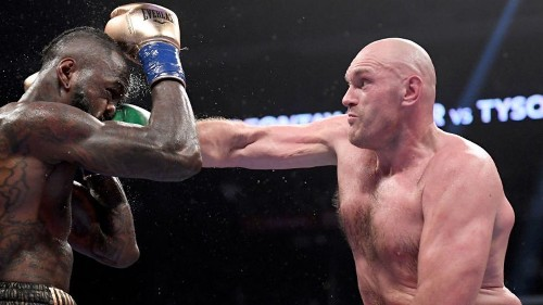 Tyson Fury signs with Top Rank/ESPN, complicating a Deontay Wilder rematch