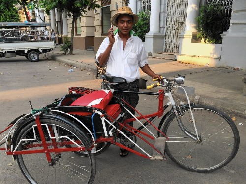 In Myanmar, sidecars still a popular mode of transport