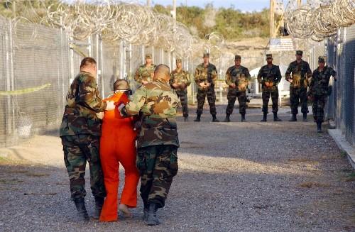 Transfer of 10 more prisoners brings Guantanamo population below 100
