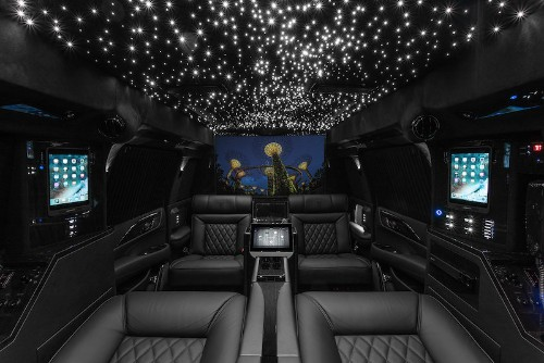 """Hyper-Luxury 2019 Cadillac Escalade Retrofitted With Multiple iPad Pros, Mac Mini, 48"""" Curved Smart TV, and More"""