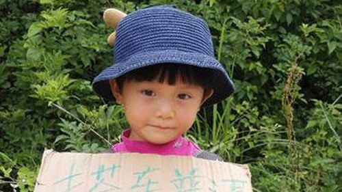 Adorable 4-year-old girl is a seasoned backpacker who has travelled half of China