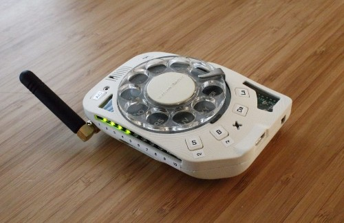 Engineer replaces her flip phone with a DIY rotary phone. Yes, it's portable.