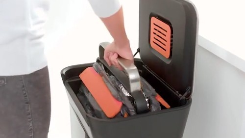 This trash can crushes your garbage to save space