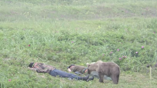 Bear cub scares the crap out of two dudes just trying to take a nap