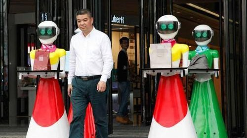 Chinese tycoon flaunts wealth by going shopping with 8 robotic maids