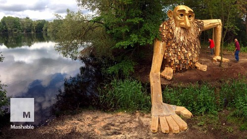Artist builds gentle giants from scrap wood and hides them throughout his city