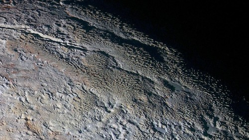 Pluto has mysterious 'dragon scales' in new photos