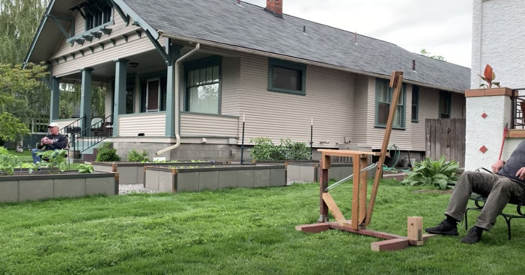 Watch two neighbors make the most of social distancing with a beer catapult