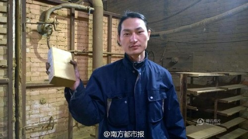 Chinese artist creates a brick from Beijing's smog that he vacuumed