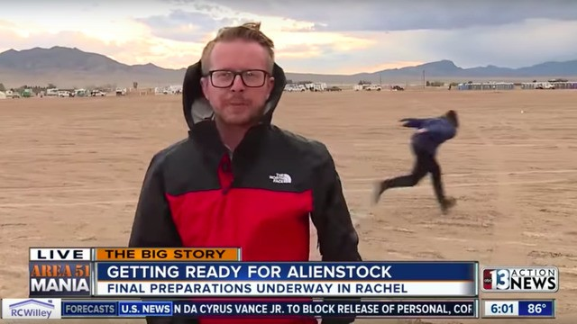 Hero kid Naruto runs behind a reporter on live TV outside Area 51