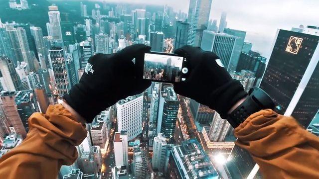 Russian Daredevils Hack Billboard on Top of Hong Kong Skyscraper
