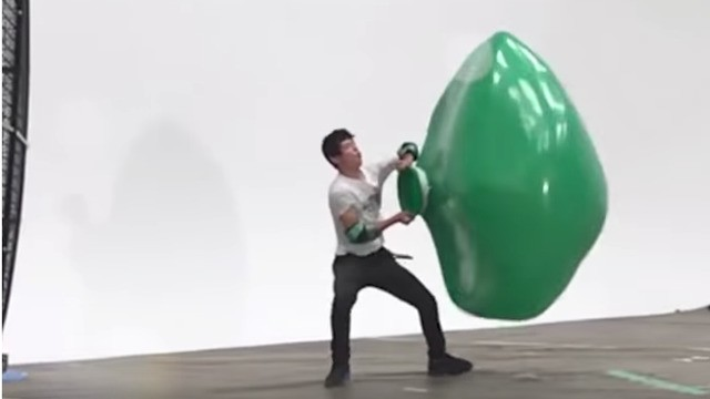 Please watch a man valiantly try to fill a balloon with the power of a giant fan