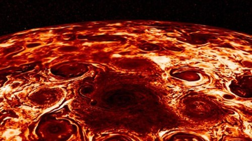 Fly above Jupiter's terrifying north pole in new NASA video