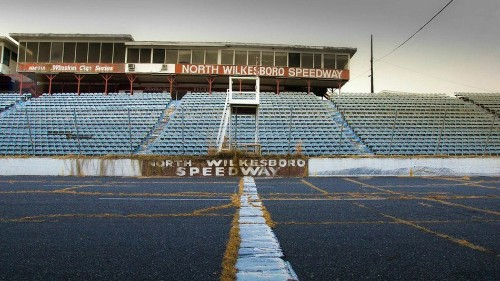 Inside an abandoned NASCAR speedway that has run its final lap